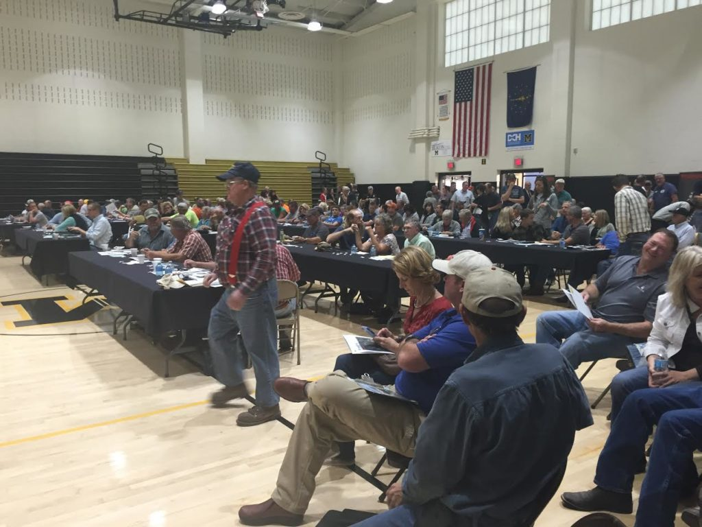 Farmland auctions in Indiana and Ohio attract big crowds, competitive bidding