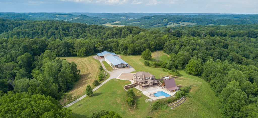 Luxury home, pasture, equine facility and land selling in online auction